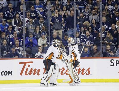 JOHN WOODS / THE CANADIAN PRESS</p><p>Anaheim Ducks goaltender Chad Johnson (1) comes in for John Gibson (36) after Winnipeg Jets scored six goals in the first period NHL action in Winnipeg on Saturday, February 2, 2019.</p>