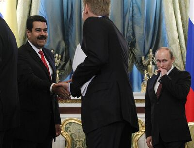 Russia's President Vladimir Putin, right, looks on as his Venezuelan counterpart Nicolas Maduro, left, shakes hands with presidential spokesman Dmitry Peskov during a meeting at the Kremlin in Moscow, Tuesday, July 2, 2013. Russian news agencies Tuesday quoted President Vladimir Putin's spokesman Dmitry Peskov as saying that Snowden withdrew his request when he learnt about the terms Moscow has set out. (AP Photo/Maxim Shemetov, pool)