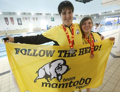 John Woods / Winnipeg Free Press</p><p>Special Olympic medallists Quinlan Roberts (left) and Samantha Currie show off their 50-metre backstroke medals at Pan Am Pool on Thursday.</p></p>