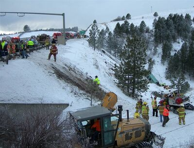 Rescue workers and vehicles respond to a tour bus crash in Pendleton, Ore., Sunday, Dec.30, 2012. Investigators in Oregon are trying to piece together the final moments before a Vancouver-bound tour bus carrying 48 people careened down a steep hillside, ejecting some of the passengers and killing nine.THE CANADIAN PRESS/HO-Oregon State Police