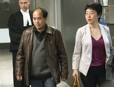Daran Lin, father of victim Jun Lin, leaves the court accompanied by his translator in Montreal on Monday, April 8, 2013. The preliminary hearing is underway for Luka Rocco Magnotta, the man charged in connection with the infamous body-parts case that made international headlines. THE CANADIAN PRESS/Ryan Remiorz