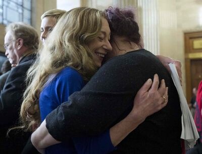 Valerie Scott and Amy Lebovitch embrace after learning of the high court's ruling.
