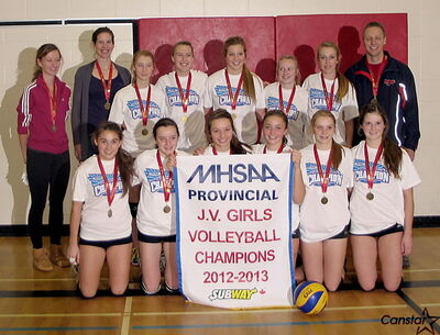 The MBCI junior varsity girls celebrate their provincial championship win over St. Mary's.