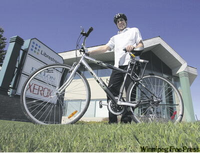 Ash Raichura, an engineer at Dillon Consult­ing, with a bicycle he and staff use to run errands.
