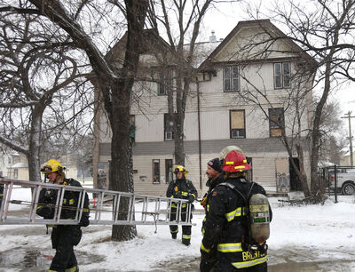 WAYNE GLOWACKI / WINNIPEG FREE PRESS FILES  Firefighters were called to a rooming house in the 600 block of Balmoral Street near Notre Dame Avenue Dec. 4. A man was hurt, and other tenants evacuated safely.