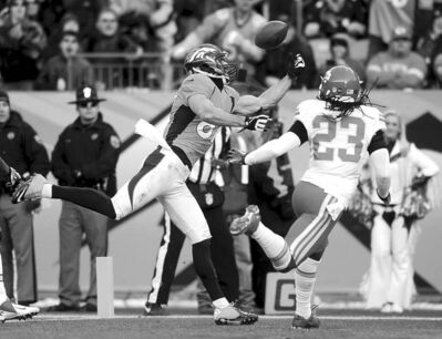 Broncos' wide receiver Erick Decker makes a 16-yard touchdown catch in front of Kansas City's Kendrick Lewis during the second quarter Sunday.