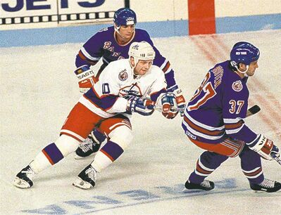 After the shortened 1994-95 season, Winnipeg's Alexei Zhamnov was third in the league for scoring with 65 points.