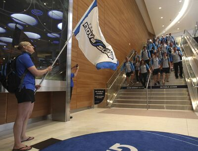 JOE BRYKSA / WINNIPEG FREE PRESS</p><p>Team Nova Scotia Mission Staff Laura Pomeroy waves the team&#39;s flag as Nova Scotia athletes arrive at Winnipeg&rsquo;s Richardson International Airport.</p>