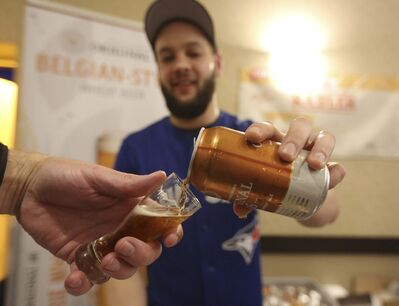 Logan Henry pours a sample at the 2018 Brandon Beer Tasting Festival. The 2019 iteration of the event takes place April 6 at the Victoria Inn from 7 to 10 p.m. (Ian Froese /Brandon Sun files) </p>