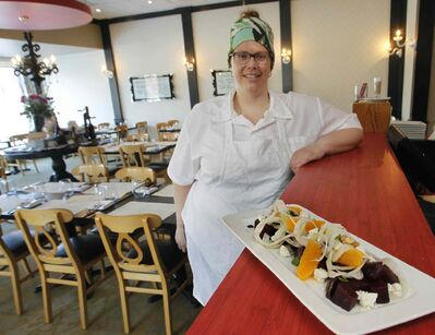 Co-owner Heather Neskar with the agro dolce beet salad.