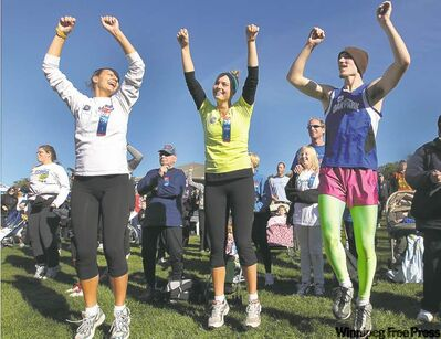 Stretching for a cause: Sarah Oswald, Karen Oswald and Luke Cameron (from left) stretch just before the Terry Fox run at Assiniboine Park Sunday.