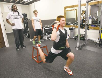 KEN GIGLIOTTI / WINNIPEG FREE PRESS Kito Poblah (left) supervises a workout with local high schoolers Griffin Shillingford (right) and Kellen Poole.