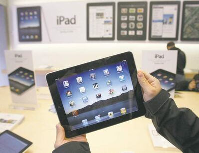 Paul Sakuma / The Canadian Press ArchivesMulti-tablet homes are not far in the future, an analyst predicts.
