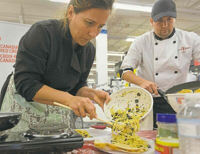 Chefs Heather Porteous and Chris Buffington prepare non-perishable food items during the Disaster Dining competition Thursday.