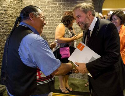 Federal NDP Leader Tom Mulcair greets well wishers as he arrives to address the Assembly of First Nations congress in Montreal on Tuesday, July 7.
