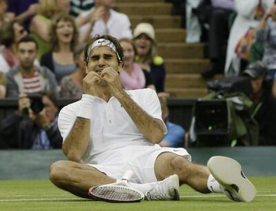 Roger Federer reacts just after the final point dropped to give him his seventh title at Wimbledon.