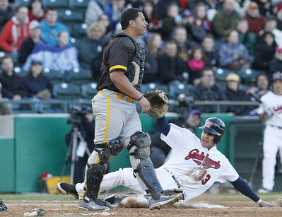 Winnipeg Goldeyes' Josh Mazzola slides into home base during Tuesday's home opener against the Amarillo Sox.