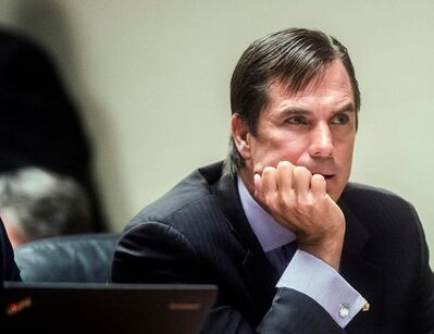 FILE - In this Aug. 20, 2018, file photo, Nick Lyon, former director of the Michigan Department of Health and Human Services, listens during Lyon's preliminary examination at Genesee District Court in Flint, Mich. Former Michigan Gov. Rick Snyder, Lyon, and other ex-officials have been told they're being charged after a new investigation of the Flint water scandal, which devastated the majority Black city with lead-contaminated water and was blamed for a deadly outbreak of Legionnaires' disease in 2014-15, The Associated Press has learned. (Jake May/The Flint Journal via AP, File)