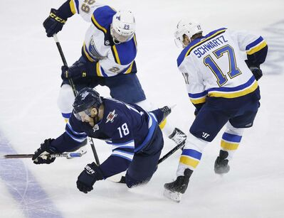 <p>Winnipeg Jets' Bryan Little gets tripped up by St. Louis Blues' Jaden Schwartz during the third period of the Jets' 2-1 playoff loss to the Blues on Wednesday.</p>