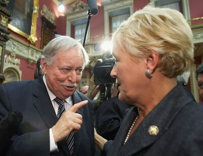 Parti Quebecois Leader Pauline Marois listens to former Quebec premier Jacques Parizeau at her swearing-in ceremony at the Quebec legislature in 2007.