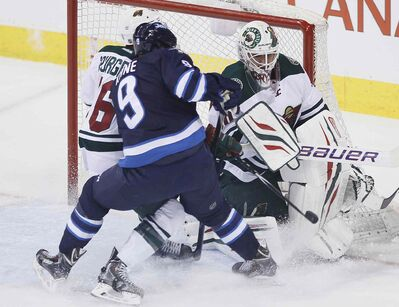 Minnesota Wild goaltender Ilya Bryzgalov stops the rush from Winnipeg Jets forward Evander Kane as the Wild's Jared Spurgeon helps out during first-period NHL action at the MTS Centre in Winnipeg on Monday.