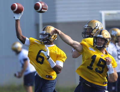 Dominique Davis (6) throws the ball at a practice in September, alongside Matt Nichols (15), and Brian Brohm. Davis will get his first CFL start against the Argos this Friday.