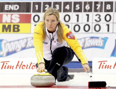 Manitoba skip Cathy Overton-Clapham delivers a rock against Nova Scotia during the morning draw Tuesday.