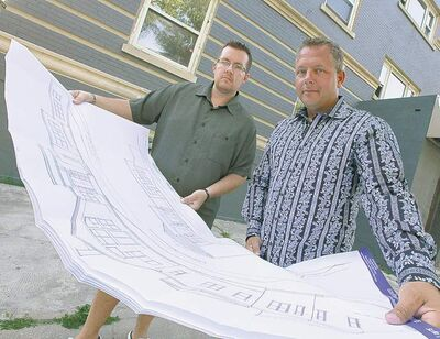 John Woods / Winnipeg Free PressWintec general manager Jeff Eales (left) and president Michael Romani look at drawings in front of 540 Maryland St. Sunday.