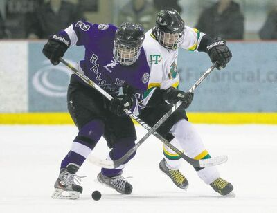 john woods / winnipeg free pressOak Park Raider Shane Kustra-Nelson (left) and John Taylor Piper Alexander McLean fight for the puck in Monday�s Game One of the WHSHL final.