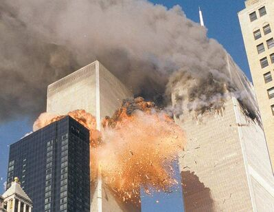 In this September 11, 2001 file photo, smoke billows from World Trade Center Tower 1 and flames explode from Tower 2 as it is struck by American Airlines Flight 175, when terrorists crashed hijacked airliners into the buildings.