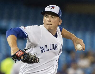 Toronto Blue Jays starting pitcher Ryan Borucki throws during first inning American League MLB baseball action against the Cleveland Indians, in Toronto on July 22, 2019. The Toronto Blue Jays are being cautious with Ryan Borucki to start spring training after the left-hander complained of elbow tightness in his throwing arm earlier this week. Blue Jays manager Charlie Montoyo said Friday at camp that Borucki experienced the tightness after throwing off a mound a couple days ago. THE CANADIAN PRESS/Fred Thornhill