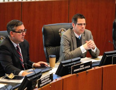 Michael Jack (left) and Mayor Brian Bowman at city hall Tuesday.