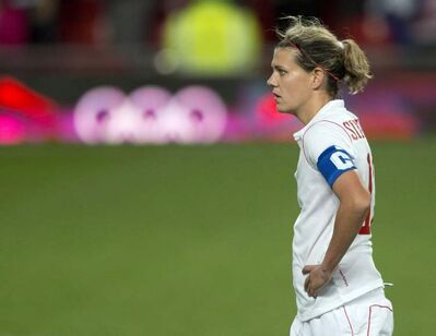 Christine Sinclair reacts after losing 4-3 in extra time in women's soccer action against the USA at the 2012 Olympic Games in London on August 6, 2012.