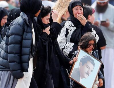 Mourners arrive for a burial service of a victim from the March 15 mosque shootings at the Memorial Park Cemetery in Christchurch, New Zealand, Thursday, March 21, 2019. (AP Photo/Vincent Thian)