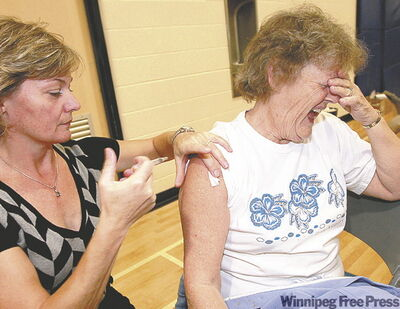 Lillian Malcovitch braces for her first-ever flu shot.