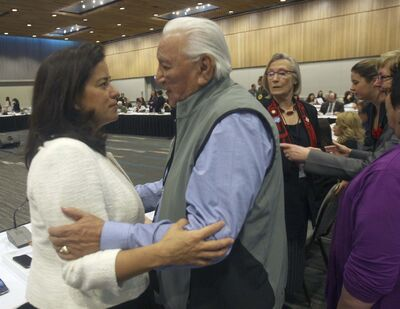 JOE BRYKSA / WINNIPEG FREE PRESS</p><p>Elmer Couchene of the Elders Council Assembly of First Nations embraces Federal Justice Minister and Attorney General Jody Wilson- Raybould at the RBC Convention Centre.</p><p>