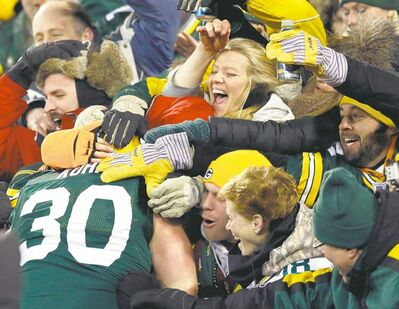 Tom Lynn  / REUTERSGreen Bay Packers fullback John Kuhn does the Lambeau Leap to celebrate his second touchdown of the game against the Minnesota Vikings.