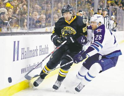 Michael Dwyer / the associated press Bruins defenceman Johnny Boychuk fights for the puck with Jets forward Blake Wheeler. Claude Noel said the Wheeler-Bryan Little line wasn't very good Monday afternoon.
