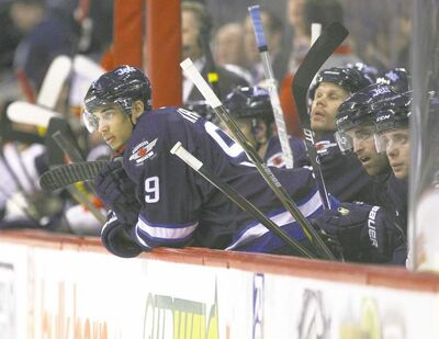JOE BRYKSA / WINNIPEG FREE PRESS archives Jets winger Evander Kane peers onto the ice, trying to remember what it is like to score a goal. Kane is getting decent chances, but has gone seven games without lighting the lamp.