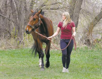 Katie Oleson, daughter of late Free Press editorial writer Tom Oleson, has had an emotional year: the deaths of her father and mother, and health problems after a fall from her horse.