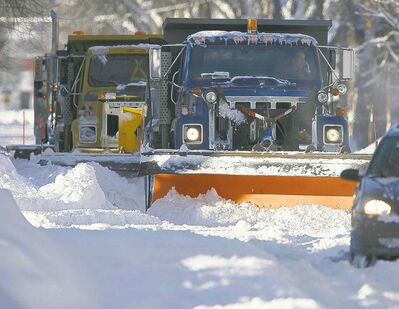 The city could save millions by reducing the width of snowplowing on streets, says a consultant's report.