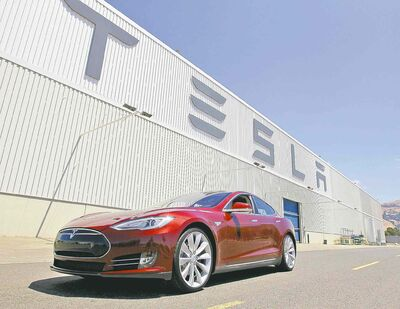 A Tesla Model S is parked outside the Tesla factory in Fremont, Calif.