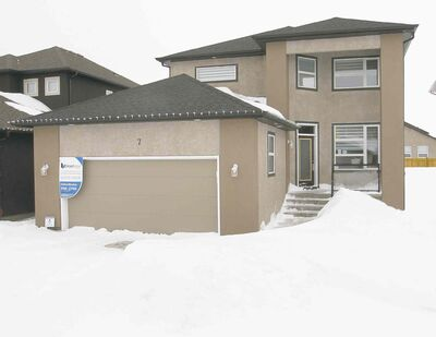 7 Grey Owl Place is an affordable two-storey, three-bedroom home in Sage Creek.