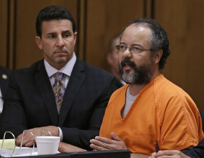 Ariel Castro, right, speaks during the sentencing phase as defense attorney Craig Weintraub watches Thursday, Aug. 1, 2013, in Cleveland. Castro was sentenced to life in prison plus 1,000 years. (AP Photo/Tony Dejak)