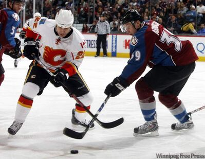 Colorado Avalanche center Tyler Arnason, right, breaks up a pass to Calgary Flames center Daymond Langkow in 2009.