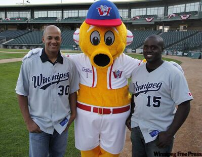 Kevin West, left, and Vince Harrison hang out with Goldie in their new away uniforms.