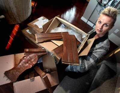 Monica Huisman shows off several boxes containing pieces of an heirloom antique chair, which was intact when it was shipped from the Netherlands.