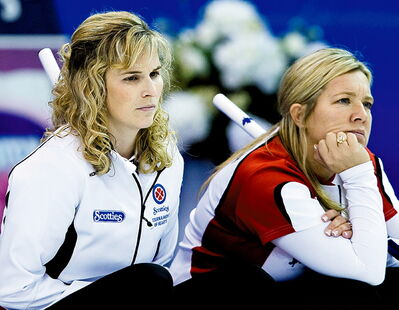 Team Canada skip Jennifer Jones, left, and third Cathy Overton-Clapham, watch while playing Yukon/NWT Monday.