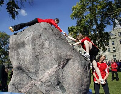Teams of three students will race across the front lawn of Wesley Hall on the U of W campus to scale the 25-ton granite Rock of Remembrance, trying to break the 9.8-second record set in 1979.