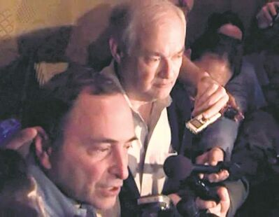 In this image from video, NHL commissioner Gary Bettman and NHLPA executive director Donald Fehr announce the new contract to news media.